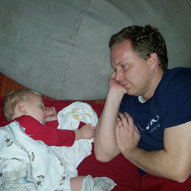Sick Dad Snuggling Sleeping Baby